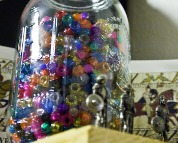 mason jar holds beads