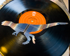 Dinosaur Upholstery Fabric on Vinyl Record Album