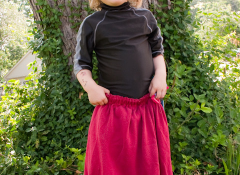 Turn an old tee into a child's skirt with this simple tshirt to skirt tutorial!