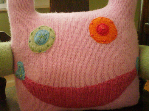 Plust doll made from repurposed sweaters.