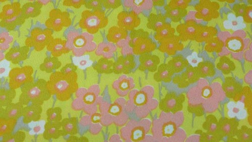 Vintage floral fabric in yellows, pinks, and greens.