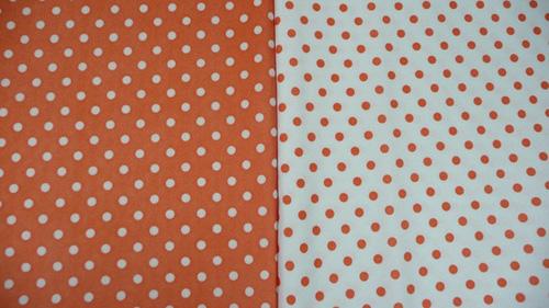 Vintage polkadots in orange and white.