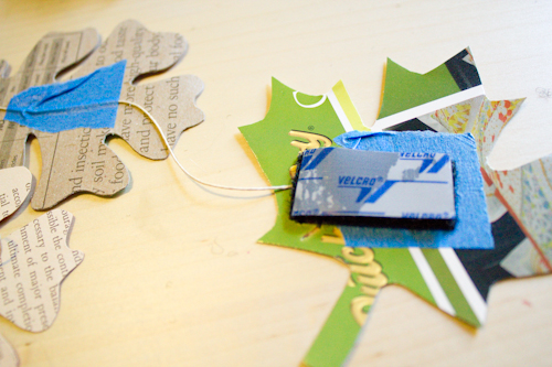 attach adhesive Velcro to the ends of the garland