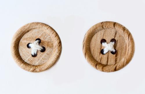 wooden buttons image via Shutterstock