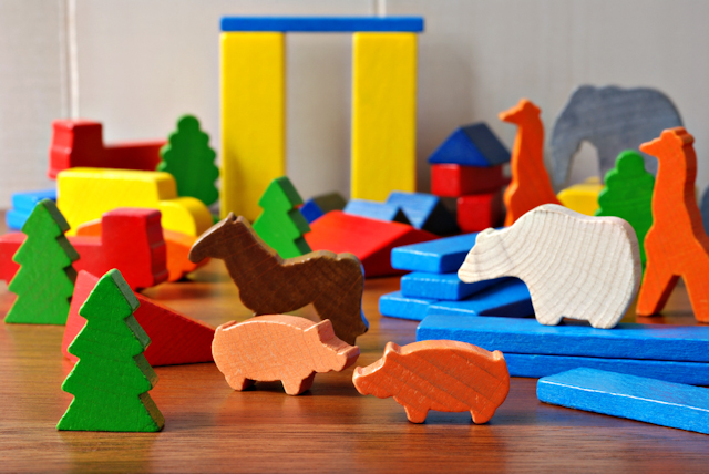 painted wooden toys image via Shutterstock