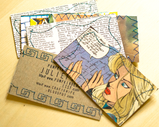 business cards made from recycled paper, embellished with stamps and sewing