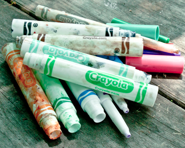 plastic barrels and caps from Crayola markers, ready to recycle
