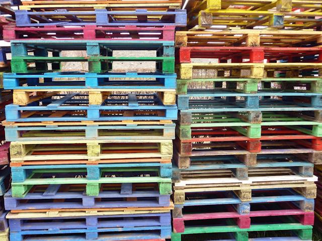 wooden pallets image via Shutterstock