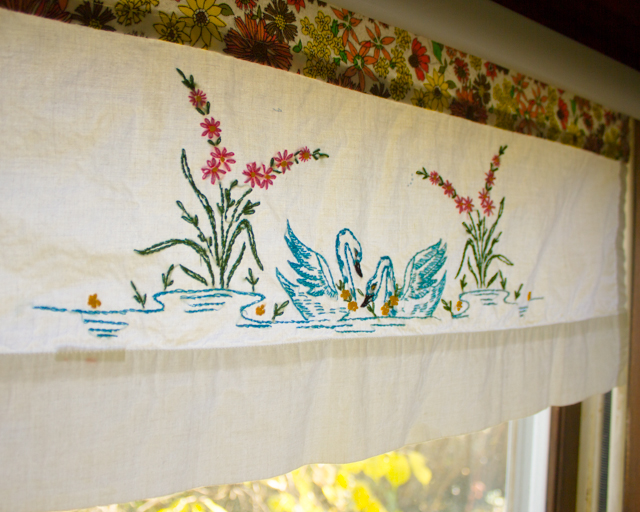 roller shade repaired with stash fabric and a vintage pillowcase