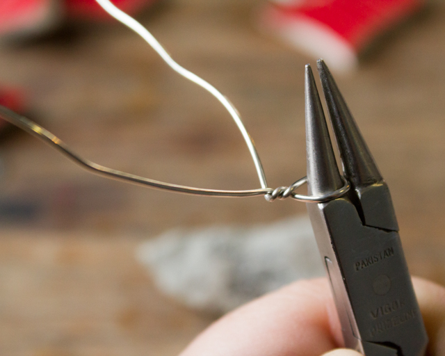 Use needlenose pliers to put a hanging loop into the wire before you wrap your object.