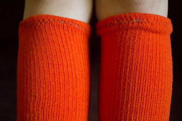 hemmed knee socks actually reach her knees now