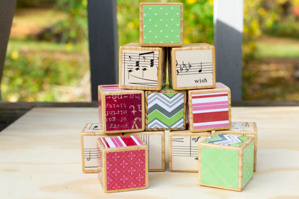 Ways to Embellish Wood: Decoupage alphabet blocks that your kids no longer play with to give them a new life. They make excellent holiday decorations!