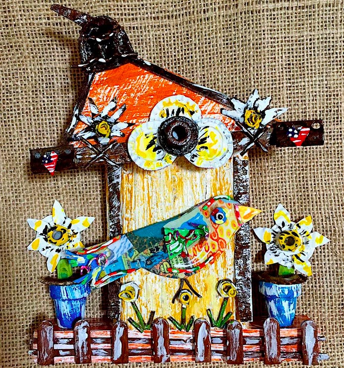 Mixed media artist Deane Bowers* makes vibrant, cheerful upcycled folk art pieces.