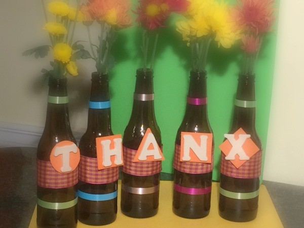 Make these DIY Thanksgiving centerpieces from beer bottles!