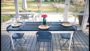 Discarded front doors are such a stellar curbside score. Here's how to turn a door into a dining table. It's easier than you might think!