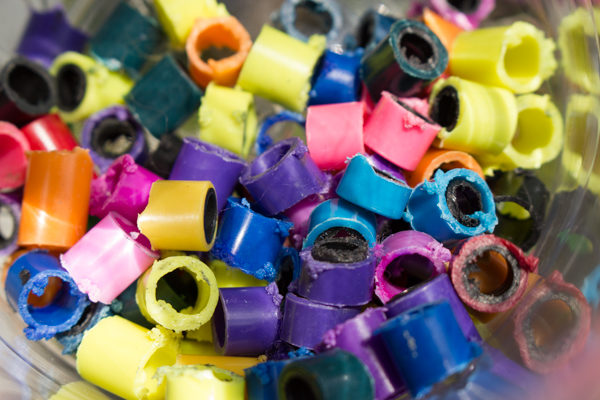These colorful beads used to be dried out markers! Upcycled marker beads are easy to make, if a little messy.