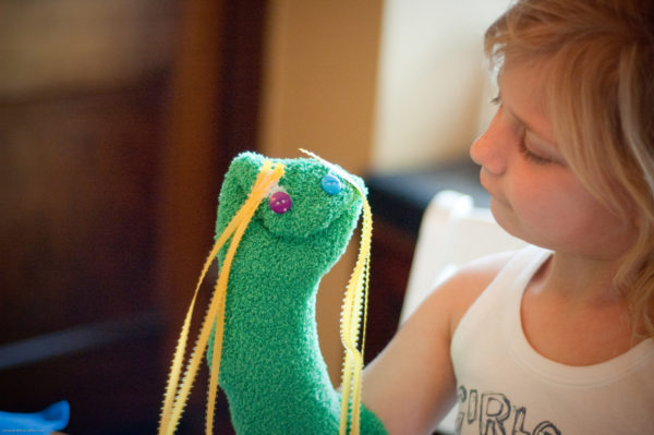child with hand puppet