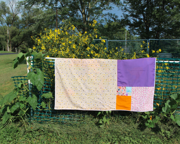 Fibonacci quilt hanging on fence