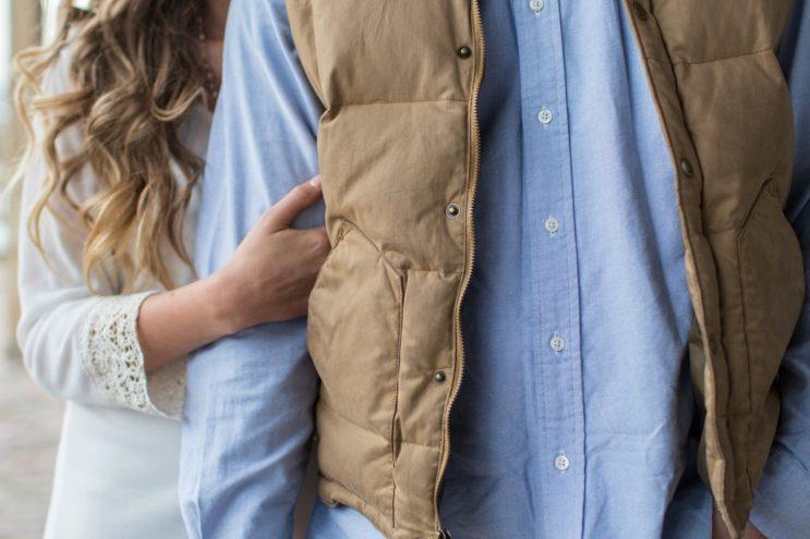 man wearing vest