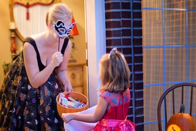 women and child wearing halloween costume