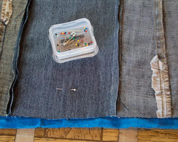 pins on denim strips