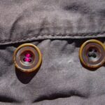 button on pants