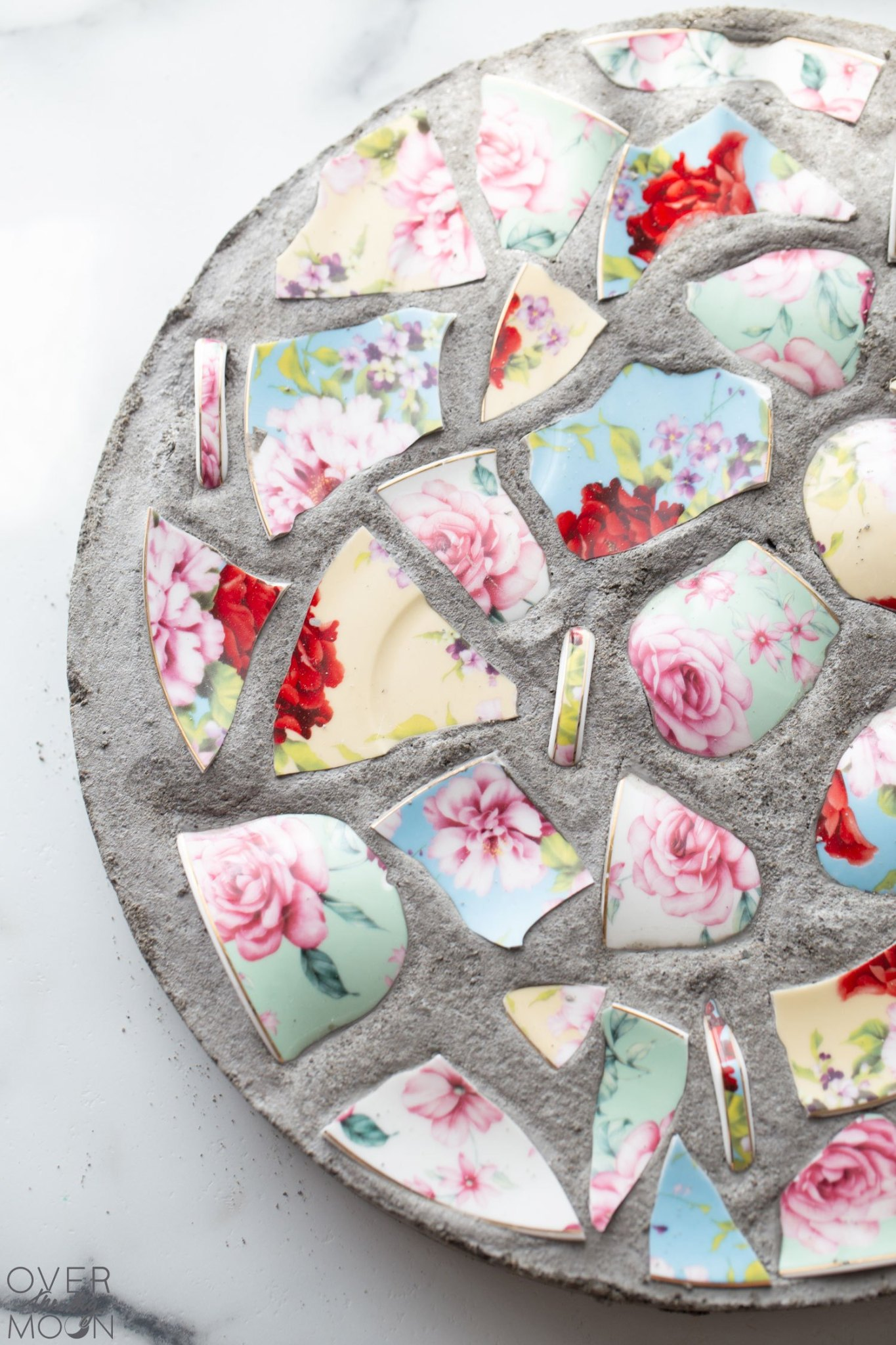 ways to upcycle broken dishes to stepping stones