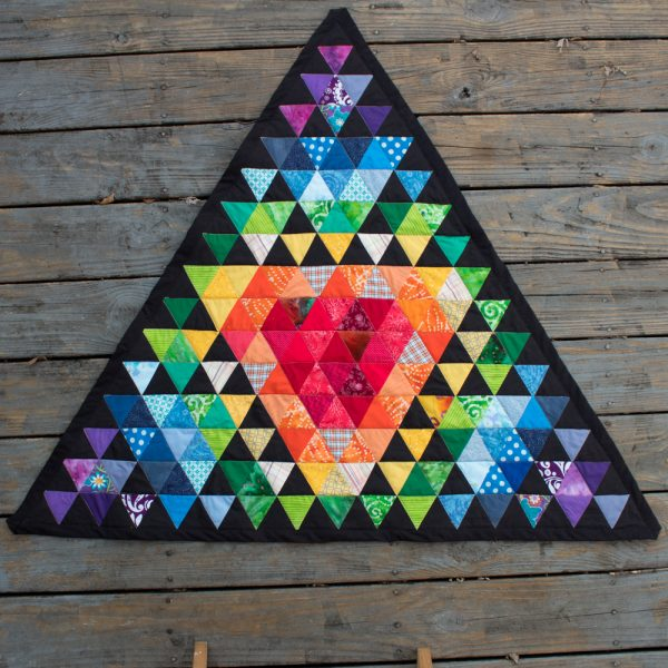 https://cdn.craftingagreenworld.com/wp-content/uploads/2021/04/Rainbow-Sierpinski-Triangle-Quilt-600x600.jpg
